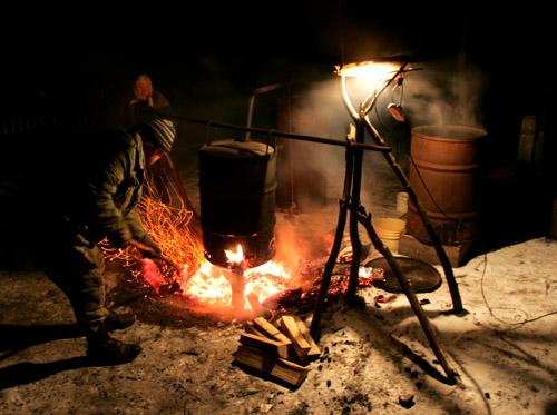 A villager produces moonshine vodka. Photo by Julia Darashkevich